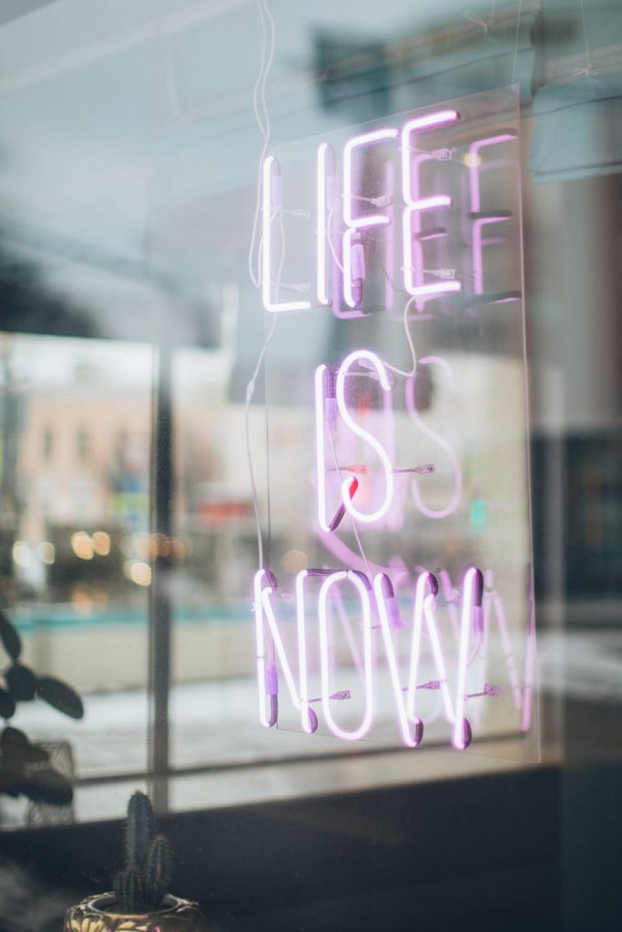 life is now neon signage